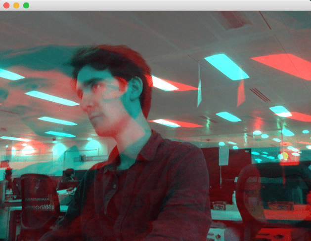 Struan appears with a blue hue in an office. A larger image with a red hue appears stretched and super imposed over the original image. Struan is confused.